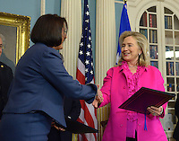 December 14, 2011  (Washington, DC)  U.S. Secretary of State Hillary Clinton  and the President of Kosovo, Atifete Jahjaga (left), shake hands after signing a cultural heritage preservation agreement i the Treaty Room at the Department of State.    (Photo by Don Baxter/Media Images International)