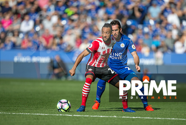 Nathan Redmond of Southampton holds off Christian Fuchs of Leicester City during the Premier League match between Leicester City and Southampton at the King Power Stadium, Leicester, England on 2 October 2016. Photo by Andy Rowland.
