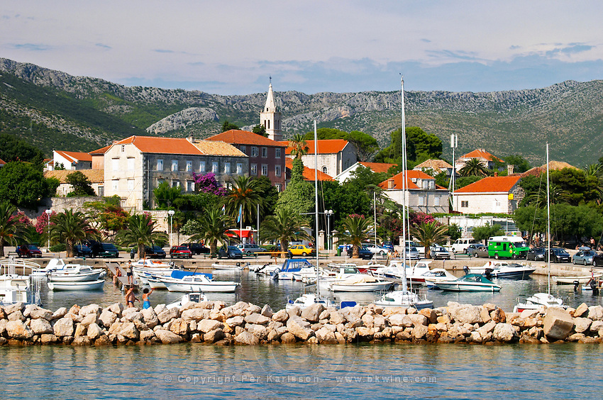 The pleasure boat harbour and the village. Orebic town, holiday resort on the south coast of the Peljesac peninsula. Orebic town. Peljesac peninsula. Dalmatian Coast, Croatia, Europe.