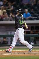 Omar Narvaez (14) of the Charlotte Knights follows through on his swing against the Columbus Clippers at BB&T BallPark on May 3, 2016 in Charlotte, North Carolina.  The Clippers defeated the Knights 8-3.  (Brian Westerholt/Four Seam Images)