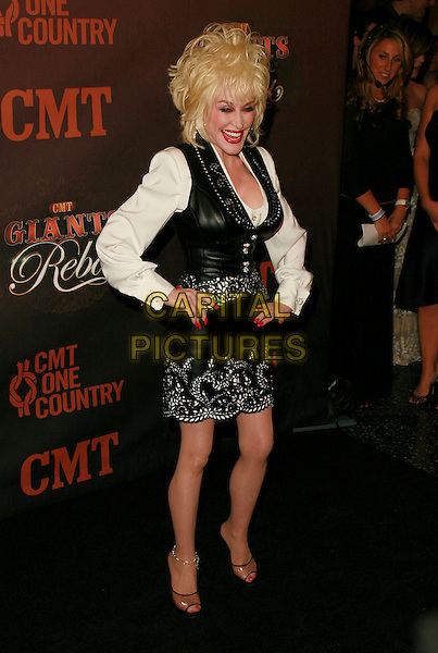 DOLLY PARTON.At CMT Giants honoring Reba McEntire held at the Kodak Theatre, Hollywood, LA, California, USA.26 October 2006..full length red lipstick black leather waistcoat skirt white shirt hands on hips.Ref: ADM/CH.www.capitalpictures.com.sales@capitalpictures.com.©Charles Harris/AdMedia/Capital Pictures.