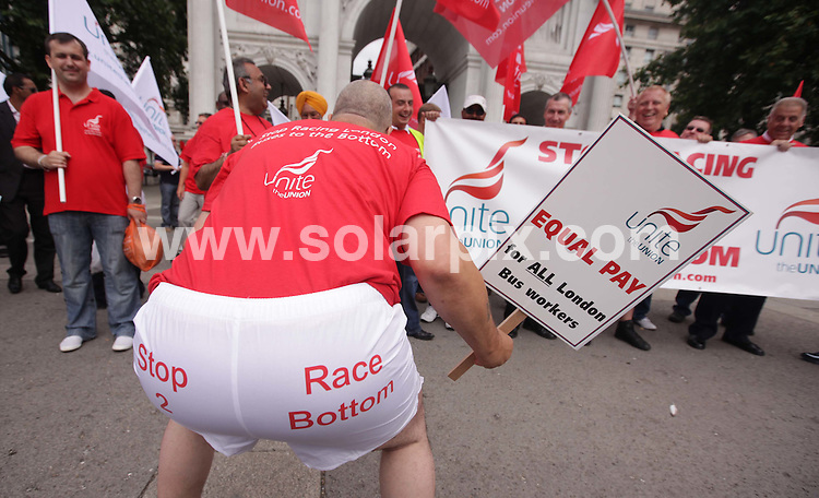 **ALL ROUND PICTURES FROM SOLARPIX.COM**.**NO UK NEWSPAPER PUBLICATION**.**UK MAGAZINE & SUPPLEMENT PUBLICATION ONLY** AND NO PUBLICATION IN AUSTRALIA, FRANCE, GERMANY, ITALY AND SCANDINAVIA** .London bus drivers protested in their boxer shorts this morning in protest against wage disparity. The workers union Unite argues that their is a  huge disparity in wages between different bus companies and can. vary as much as £10,000 a year. London, UK. 5 August 2009..This pic: London bus drivers protest..JOB REF: 9696 SFE       DATE: 05_08_2009.**MUST CREDIT SOLARPIX.COM OR DOUBLE FEE WILL BE CHARGED**.**MUST NOTIFY SOLARPIX OF ONLINE USAGE**.**CALL US ON: +34 952 811 768 or LOW RATE FROM UK 0844 617 7637**