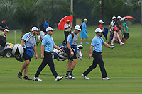 Tyrrell Hatton and Paul Casey (Europe) on the 3rd fairway during the Saturday Foursomes of the Eurasia Cup at Glenmarie Golf and Country Club on the 13th January 2018.<br /> Picture:  Thos Caffrey / www.golffile.ie