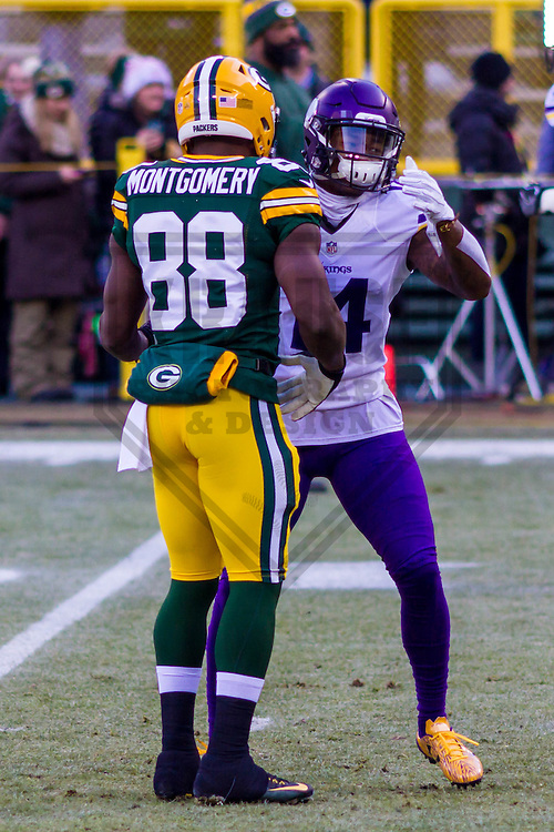 Green Bay Packers running back Ty Montgomery (88) and Minnesota Vikings wide receiver Stefon Diggs (14) prior to a game on December 24th, 2016 at Lambeau Field in Green Bay, Wisconsin.  Green Bay defeated Minnesota 38-25. (Brad Krause/Krause Sports Photography)