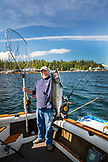 USA, Alaska, Ketchikan, Captain Tony shows off his catch while fishing the Behm Canal near Clarence Straight, Knudsen Cove along the Tongass Narrows