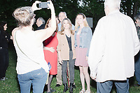 Democratic presidential candidate and spiritual guru Marianne Williamson greets people after speaking to a small crowd in the back yard of Kathleen O'Donnell at a campaign house party event in Keene, New Hampshire, on Wed., May 22, 2019.