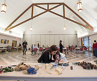 NWA Democrat-Gazette/J.T. WAMPLER  Zenna Arens, 9, (left) and Edie Brannon, 10, both of Fayetteville, make wreaths Sunday Nov. 29, 2015 at St. Paul's Episcopal Church in Fayetteville. For a donation people were able to construct their own Advent Wreaths for the holiday season.