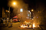 Rioters set a car on fire behind the state legislature building, in Rio de Janeiro, Brazil, Monday, June 17, 2013. Protests in Sao Paulo, Rio de Janeiro and other major Brazilian cities began with a 20-cent hike in public transport fares, have clearly moved beyond that issue to widespread frustration in Brazil about a heavy tax burden, politicians widely viewed as corrupt and woeful public education, health and transport systems and come as the nation hosts the Confederations Cup soccer tournament and prepares for next month's papal visit. <br /> <br /> Monday's demonstration brought a record 100,000 protestors who expressed their frustration at the heavy-handed policing, poor public services and high costs for the World Cup. The majority of Rio's protestors were peaceful, however a large group attacked the state legislature building, setting a car and other objects ablaze. Rio state security officials say at least 20 officers and 9 protesters were injured.
