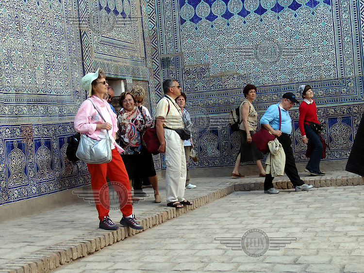 Italian tourists visit the Harem at the Tash Hauli Palace.
