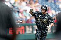 Vanderbilt Commodores outfielder Stephen Scott (19) rounds third base after hitting a home run during the second inning of Game 8 of the NCAA College World Series against the Mississippi State Bulldogs on June 19, 2019 at TD Ameritrade Park in Omaha, Nebraska. Vanderbilt defeated Mississippi State 6-3. (Andrew Woolley/Four Seam Images)