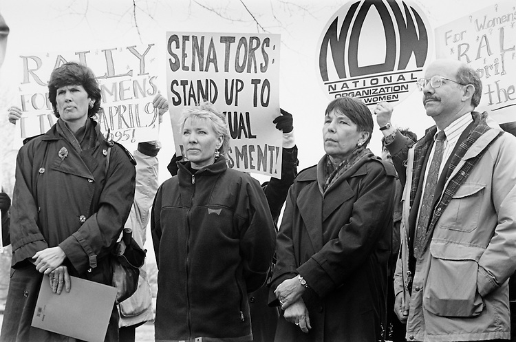 Former NOW President Molly Yard delivers petitions Rep. Peter DeFazio and stands with two accusers of Sen. Bob Packwood, R-Ore., on sexual harassment,Mary Heffernan and Gena Hutton.  After a press conference, Mary and Gena went over to Bob Dole's Office in the Hart Building. March 1995 (Photo by Maureen Keating/CQ Roll Call)