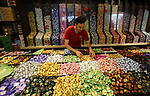 A Palestinian vendor sells chocolate at a store a few days ahead of Eid al-Fitr holiday in Gaza city on June 2, 2019. Eid al-Fitr marks the end of Muslim's holy fasting month of Ramadan when faithfuls abstain from eating, drinking, smoking and sexual activities from dawn to dusk. Photo by Ashraf Amra