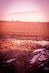 Winter in the countryside with a ploughed field in Suffolk England