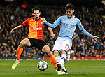 David Silva of Manchester City shoots past Taras Stepanenko of Shakhtar Donetsk during the UEFA Champions League match at the Etihad Stadium, Manchester. Picture date: 26th November 2019. Picture credit should read: Darren Staples/Sportimage