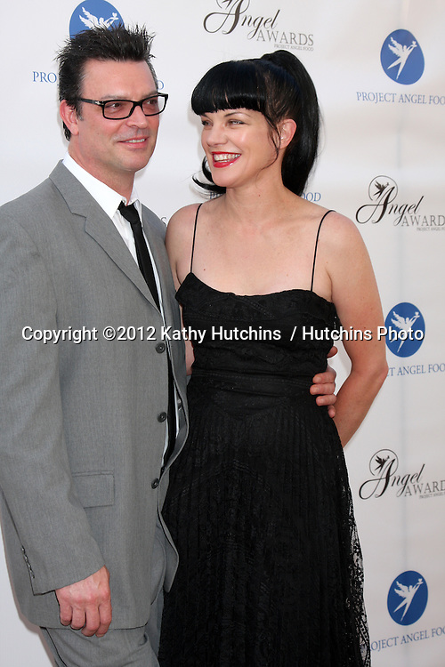 LOS ANGELES - AUG 18:  Pauley Perrette, and fiance arrives at the 17th Annual Angel Awards at Project Angel Food on August 18, 2012 in Los Angeles, CA