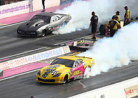 Oct 29, 2016; Las Vegas, NV, USA; NHRA pro mod driver Troy Coughlin (near) alongside Shane Molinari during qualifying for the Toyota Nationals at The Strip at Las Vegas Motor Speedway. Mandatory Credit: Mark J. Rebilas-USA TODAY Sports