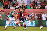Robbie Rogers (16)  of the United States is pulled down by Gerardo Torrado (6)  of Mexico earning Torrado a yellow card. The men's national teams of the United States (USA) and Mexico (MEX) played to a 1-1 tie during an international friendly at Lincoln Financial Field in Philadelphia, PA, on August 10, 2011.