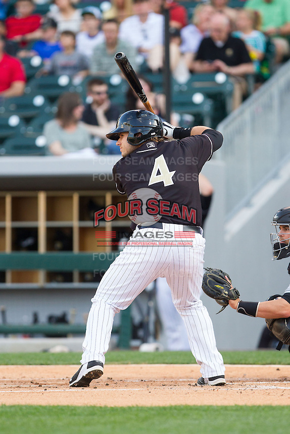 Josh Phegley (4) of the Charlotte Knights at bat against the Indianapolis Indians at BB&T Ballpark on May 23, 2014 in Charlotte, North Carolina.  The Indians defeated the Knights 15-6.  (Brian Westerholt/Four Seam Images)