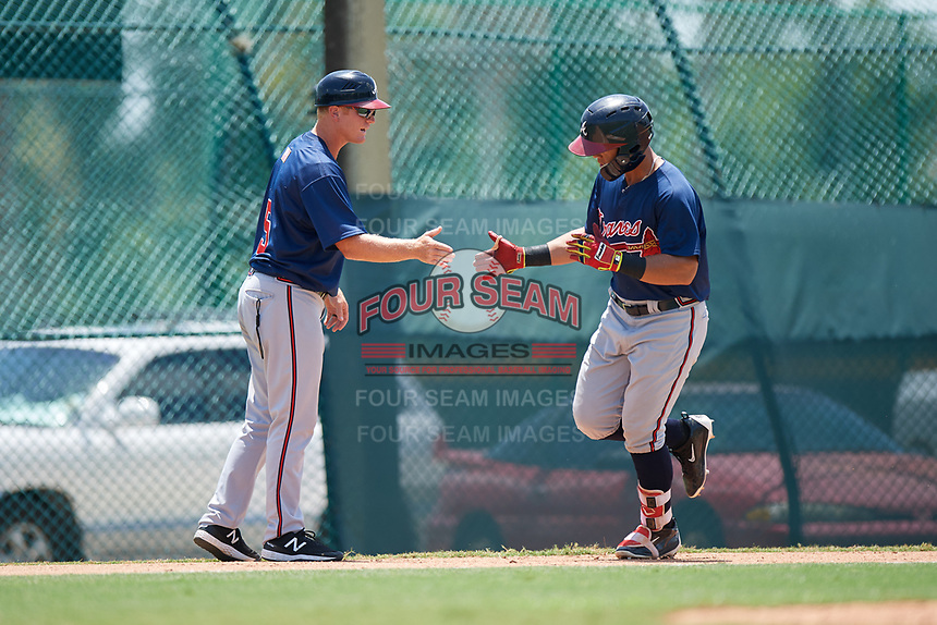 GCL Braves left fielder Jefrey Ramos (22) is congratulated by Barrett Kleinknecht (5) as he rounds third base after hitting a home run in the top of the third inning during a game against the GCL Pirates on July 26, 2017 at Pirate City in Bradenton, Florida.  GCL Braves defeated the GCL Pirates 12-5.  (Mike Janes/Four Seam Images)