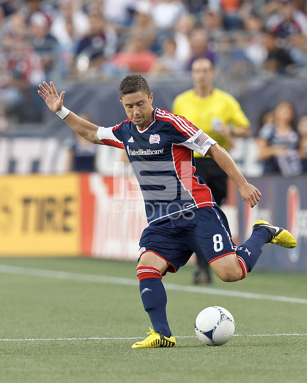 New England Revolution defender Chris Tierney (8) passes the ball. In a Major League Soccer (MLS) match, Sporting Kansas City defeated the New England Revolution, 1-0, at Gillette Stadium on August 4, 2012.