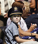 Funeral for North Brunswick Police Lt. Chris Zerby at the Franklin Memorial Park , North Brunswick. Here the police hat of Lt. Chris Zerby is worn by his son Tyler (left) during the service at the park.<br /> METRO<br /> 3066<br /> ON SAT AUG.2, 2008<br /> MARK R. SULLIVAN/CHIEF PHOTOGRAPHER
