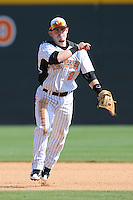 Zach Osborne #2 of the Tennessee Volunteers makes a throw to first at Lindsey Nelson Stadium against the the Manhattan Jaspers on March 12, 2011 in Knoxville, Tennessee.  Tennessee won the first game of the double header 11-5.  Photo by Tony Farlow / Four Seam Images...