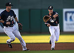 Reno Aces' Ed Lucas watches Jack Reinheimer make a play against the Sacramento River Cats at Greater Nevada Field in Reno, Nev., on Tuesday, July 26, 2016.  <br />Photo by Cathleen Allison