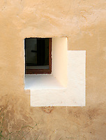 The deep inset window and painted surround are traditional to the old country houses in Ibiza