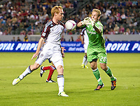 CARSON, CA - October 20, 2012: Colorado Rapids midfielder Jeff Larentowicz (4) and Chivas goalie Tim Melia (28) during the Chivas USA vs Colorado Rapids match at the Home Depot Center in Carson, California. Final score, Chivas USA 0, Colorado Rapids 2.