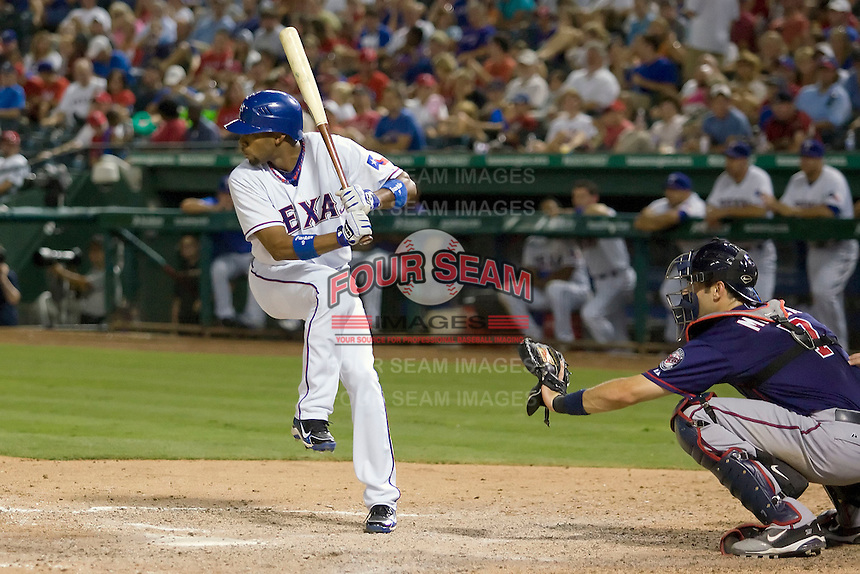 Texas Rangers outfielder Endy Chavez #9 at bat during the Major League Baseball game against the Texas Rangers at the Rangers Ballpark in Arlington, Texas on July 27, 2011. Minnesota defeated Texas 7-2.  (Andrew Woolley/Four Seam Images)