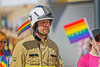 Pictured: A fireman takes part in the Pride parade as it travels through the streets of Swansea, Wales, UK. Saturday 05 May 2018<br /> Re: Spring Pride has brought a celebration of colour to the streets of Swansea in Wales, UK.<br /> Rainbow flags were flown in support of the LGBT community at the event, which is designed to raise awareness and is open to anyone to take part in.