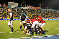 Kingston, Jamaica - Friday, June 7, 2013: USMNT 2-1 over Jamaica  during World Cup qualifying at the National Stadium. Brad Evans is mobbed by teammates after scoring the winning goal.