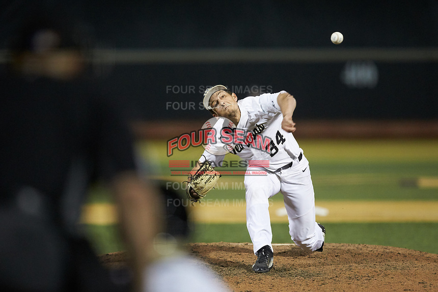 Wake Forest Demon Deacons relief pitcher Bobby Seymour (3) delivers a pitch to the plate against the North Carolina State Wolfpack at David F. Couch Ballpark on April 18, 2019 in  Winston-Salem, North Carolina. The Demon Deacons defeated the Wolfpack 7-3. (Brian Westerholt/Four Seam Images)