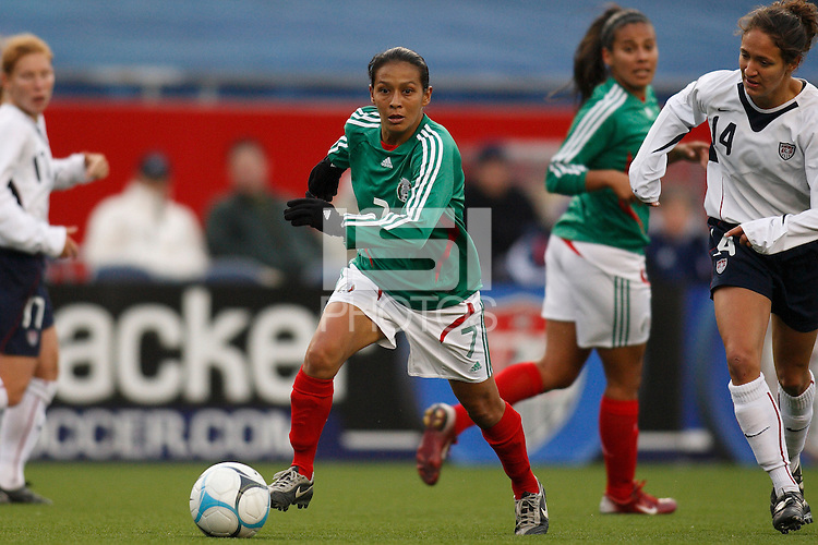 Mexico midfielder (7) Evelyn Lopez is chased by USA defender (14) Stephanie Lopez. The USA Women's National Team defeated Mexico 5-0 in an international friendly at Gillette Stadium, Foxbourgh, MA, on April 14, 2007.