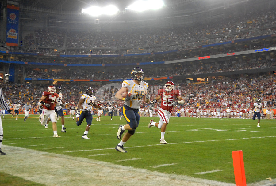 Jan 2, 2008; Glendale, AZ, USA; West Virginia Mountaineers running back Owen Schmitt (35) runs the ball for a second quarter touchdown against the Oklahoma Sooners during the Fiesta Bowl at University of Phoenix Stadium. Mandatory Credit: Mark J. Rebilas-US PRESSWIRE