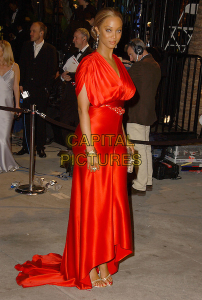 TYRA BANKS.The 2007 Vanity Fair Oscar Party Hosted by Graydon Carter held at Morton's, West Hollywood, California, USA, 25 February 2007..oscars full length red dress.CAP/ADM/GB.©Gary Boas/AdMedia/Capital Pictures.