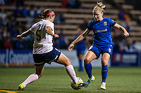 Seattle, Washington -  Sunday, September 11 2016: Washington Spirit defender Whitney Church (5) and Seattle Reign FC midfielder Kim Little (8) go for the ball during a regular season National Women's Soccer League (NWSL) match between the Seattle Reign FC and the Washington Spirit at Memorial Stadium. Seattle won 2-0.