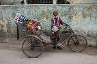 Bangladesh, Jhenaidah. Man with rickshaw.
