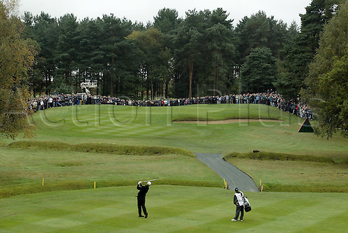 16 Oct 2004: Rear elevated view of South African golfer Ernie Els (RSA) playing his approach shot to the 7th green during his semi final match against Padraig Harrington (IRE). HSBC World Matchplay Championship, Wentworth, England. Photo: Glyn Kirk/Actionplus....041016.golf golfer iron course crowd back behind