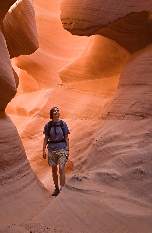 Antelope Canyon, AZ / JUL<br /> Colleen Miniuk-Sperry hikes through the Lower Antelope Canyon on the Navajo Reservation near Page, Arizona.