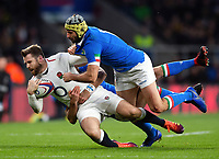 Elliot Daly of England is double-tackled to ground by Luca Morisi and Angelo Esposito of Italy. Guinness Six Nations match between England and Italy on March 9, 2019 at Twickenham Stadium in London, England. Photo by: Patrick Khachfe / Onside Images