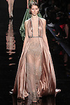 "Model walks runway in an embroidered nude column with draped silk charmeuse overdress from the Reem Acra Fall 2016 ""The Secret World of The Femme Fatale"" collection, at NYFW: The Shows Fall 2016, during New York Fashion Week Fall 2016."
