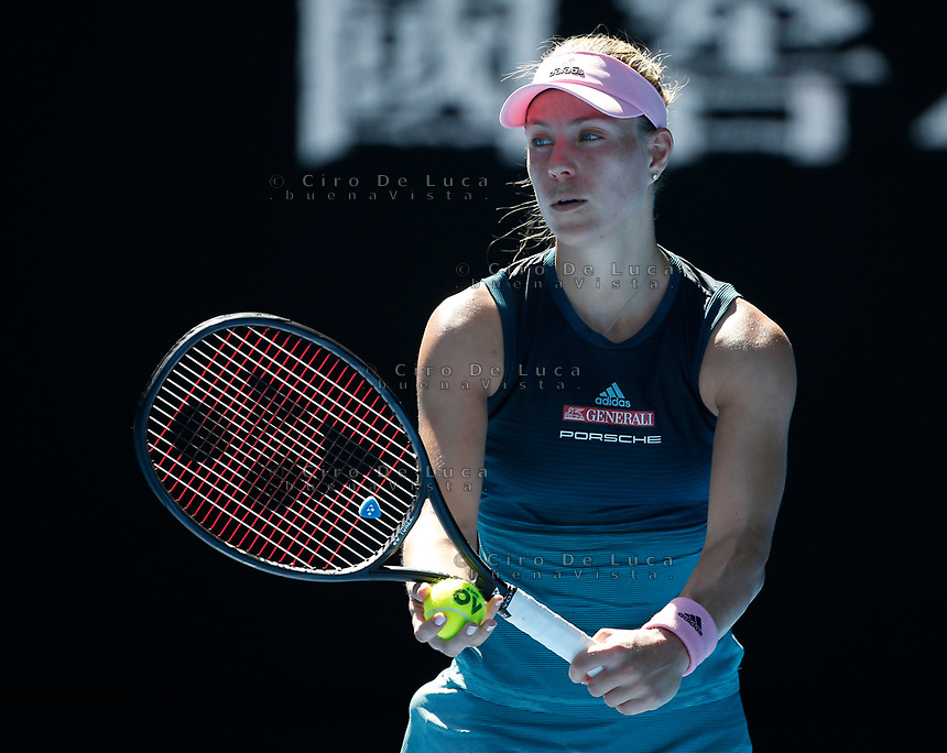 14th January 2019, Melbourne Park, Melbourne, Australia; Australian Open Tennis, day 1; <br /> Angelique Kerber of Germanyservr  a ball during a match against Polona Hercog of Slovenia