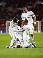 Pictured: Nathan Dyer of Swansea (on the ground) is celebrating his goal with team mates L-R Pablo Hernandez, Ashley Williams and Wayne Routledge. Sunday 24 February 2013<br />