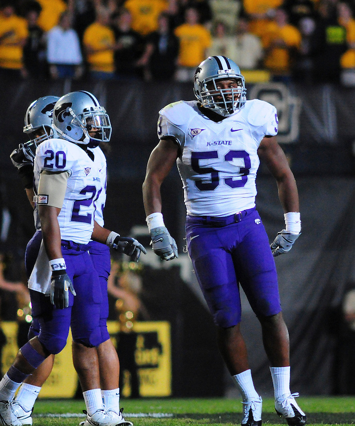 18 October 08: Kansas State linebacker Reggie Walker (53) celebrates a tackle resulting in a loss for Colorado alongside safety Courtney Herndon (20). The Colorado Buffaloes defeated the Kansas State Wildcats 14-13 at Folsom Field in Boulder, Colorado.