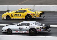 Feb 9, 2020; Pomona, CA, USA; NHRA pro stock driver Chris McGaha (near) races alongside Jeg Coughlin Jr during the Winternationals at Auto Club Raceway at Pomona. Mandatory Credit: Mark J. Rebilas-USA TODAY Sports