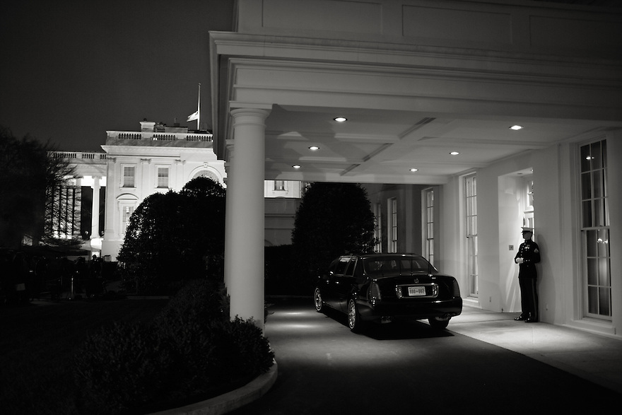 A United States Marine stands guard at the diplomatic entrance of the West Wing at the White House in Washington.