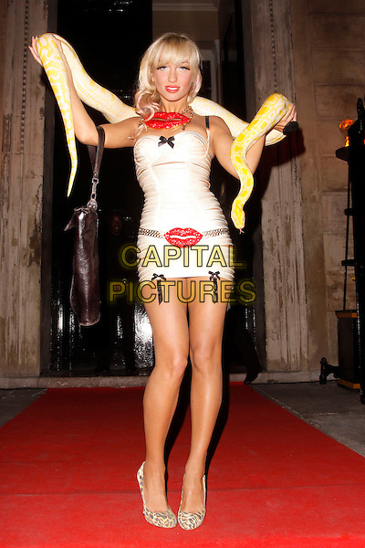 Georgina Leahy and Slinky Sebastian.UK Lingerie Awards, One Mayfair, London, England..September 19th, 2012.full length snake python animal pink strapless dress straps around shoulders red lips mouth lipstick  arms in air belt .CAP/AH.©Adam Houghton/Capital Pictures.