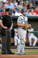 Umpire Garrett Patterson and Chattanooga Lookouts catcher Chris O'Brien (27) during game three of the Southern League Championship Series against the Jacksonville Suns on September 12, 2014 at Bragan Field in Jacksonville, Florida.  Jacksonville defeated Chattanooga 6-1 to sweep three games to none.  (Mike Janes/Four Seam Images)