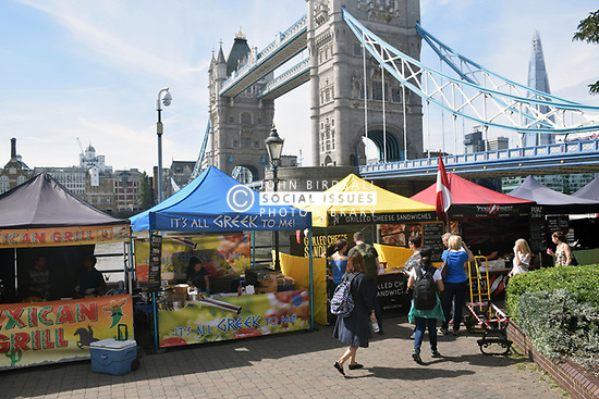 Food stalls by Tower Bridge near St Katherine's Dock, London UK